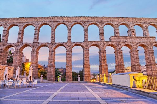 Ancient Roman aqueduct on Plaza del Azoguejo in Segovia, Spain