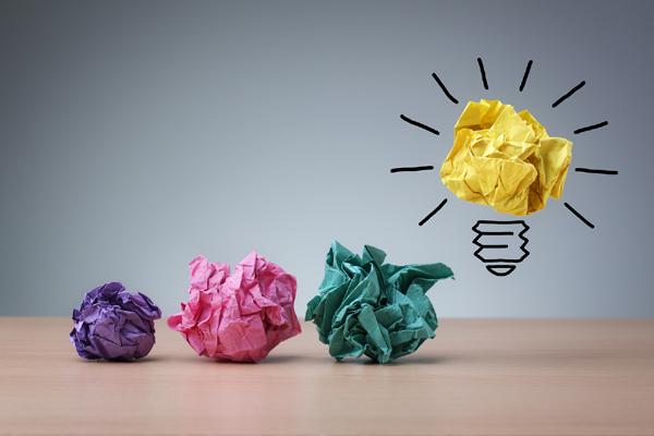 Inspiration concept crumpled paper light bulb metaphor for good